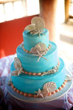 Stunning Aqua blue tinted beach wedding cake with edible candied seashells