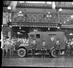 Guards stand in front of Armored Car, Louisville, Kentucky. :: University of Louisville Photographic Archives, R. G. Potter Collection, P_03379.