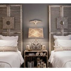 gray walls, white bedding, old door headboards