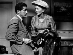 """Dana Andrews and Joan Fontaine in Beyond a Reasonable Doubt. My students thought Fontaine looked """"too old"""" for Dana, even though they were about the same age. Maybe it's the hat? One of my female students asked, """"Why did women wear hats?"""""""
