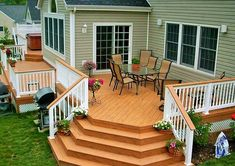 With wood anything can be made, even a staircase in the lawn as well. For providing the lawn of the house with a fancy look, you can use wooden items to decorate it. In the picture you can see, how amazing the wooden stairs and flower pots are looking.