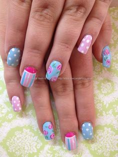 Pastel pink, blue and white freehand nail art with polka dots, stripes and roses