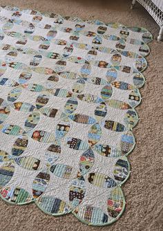 How cool is this?  I've been sewing scraps to wide adding machine tape.  This would be so easy to back myn strips with wonder under, cut out the shapes and then press them to the background piece and then just stitch down.