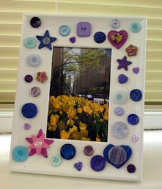 pretty white frame with hearts, stars and buttons in shades of blue and purple