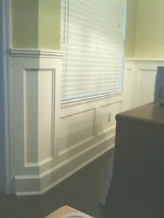 Great wainscoting for the dining room. Love the treatment under the window.
