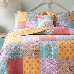 Refresh your space with the retro-inspired charm of Jessica Simpson's Sonya Reversible Quilt. It features a lovely array of textured, colorful squares pieced together in classic patchwork style, and it reverses to an orange and coral medallion print.