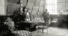 """This is a view of Claude Monet standing in his first studio amidst his favorite canvases. The light of the afternoon is almost palpable.  This room located in his main house at Giverny was turned into his sitting-room after 1890…""  via"