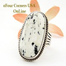 Elongated Oval White Buffalo Turquoise Ring Size 9 1/2 Native American by Navajo Silversmith Tony Garcia. Gorgeous low profile oval Stone offering a a soft spattering of signature Black and White coloring. Stone is set in Sterling Silver straight bezel with rope accent on six prong wide shank tapering to a single comfortable 3/16 inch at base