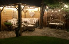 Made by my husband out of fence panels.  Great outside space to enjoy the evening without feeling cold