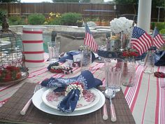 4th of July a Tablescape ideas- Rusty accessories, metal tins, bandana napkins and more!