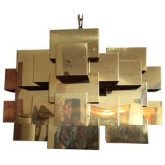 Cubist Chandelier by Curtis Jere | From a unique collection of antique and modern chandeliers and pendants  at https://www.1stdibs.com/furniture/lighting/chandeliers-pendant-lights/