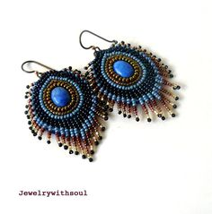 Reserved - Denim peacock feather bead embroidery earrings with denim lapis lazuli cabochons in light blue, dark navy blue, copper and gold, via Etsy.