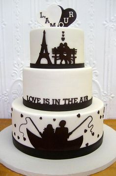 Silhouettes of a couple in love add a whimsical and romantic touch to this simple #wedding #cake by Cheryl Kleinman Cakes.