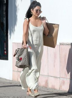 Taking the plunge:Vanessa Hudgens showed off her lingerie in a revealing maxi dress in Hollywood on Sunday