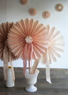 Lia Griffith teaches you how to make scalloped, frilly paper fans that are perfect for a diy wedding or backyard party project. Learn a fold-up version made with a Cricut Explore cutting machine or hand paper crafting. - Creativebug
