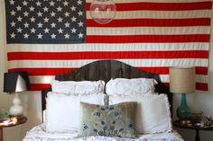 Dressing a home with #vintage finds = instant warmth. Love this room via Design*Sponge. #bedroom #americanflag