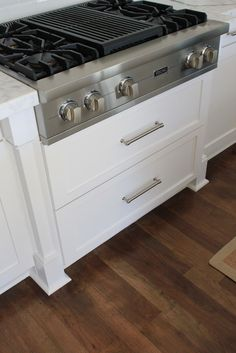 like drawers under stove top like foot at bottom of cabinets like silver drawer handles Love stove top-find one similar but less expensive