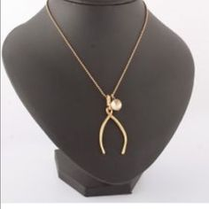 Tory Burch Wishbone Necklace Authentic never worn. Sold out, no tags but perfect new condition Tory Burch Jewelry Necklaces