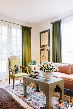 "Green accents abound in the sitting room. ""I just did that innately,"" says Elson when asked if she coordinated with her famous crimson locks. ""It's funny how you go towards certain shades."""