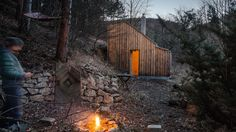 Austrian architecture studio Raumhochrosen designed this compact timber cabin as a wilderness retreat for a life coach and songwriter.