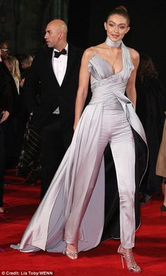 Here she comes: The supermodel commanded attention as she crossed the red carpet on Monday...