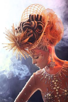 When it comes to putting on the ritz, the OMC World Cup Competition takes first prize. Shown: Model wearing a hat made entirely of hair. #OMC #hotonbeauty #fantasyhair hotonbeauty.com #hairart