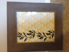 Picture frame, scrapbook paper, and stencil. Simple but cute wall art