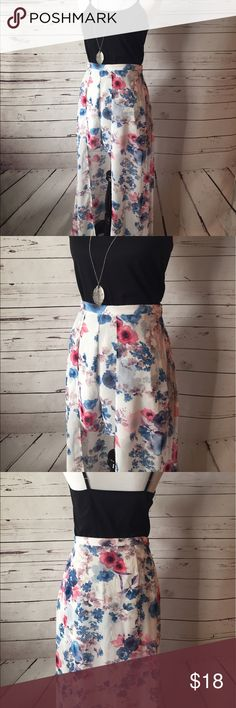 """Floral Shorts with Maxi Overlay This is such a gorgeous piece! Turn some heads with these amazing and unique shorts that have a beautiful Maxi Skirt overlay. So flattering!! Waist: 31"""" , Shorts Length: 17"""", Maxi Length 42"""". 100% Polyester. Make an offer! Peach Love Shorts Skorts"""