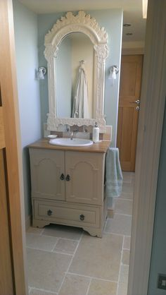 Attic build. Re-purposed vanity unit in loft bathroom painted Farrow and Ball Archive, Mirror in Farrow and Ball White Tie.