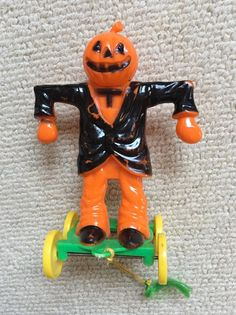 Vintage Halloween Pumpkin Head Scarecrow Candy Container Pull Toy Hard Plastic