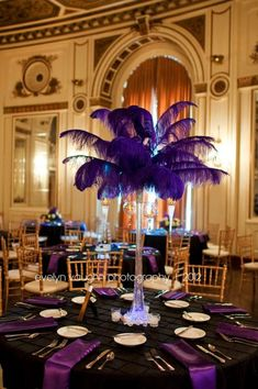 Purple Feather Centerpiece with black linen and purple napkins.