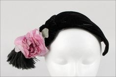 Bes-Ben black velvet bandeau with applied black feathers, a pink flower, and a matching black velvet hat pin | Made in Chicago, United States