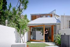 A House That Goes Modern Behind its Traditional Facade