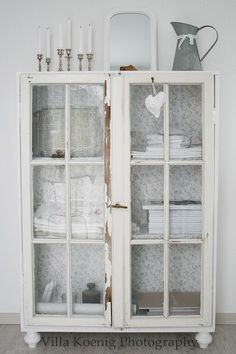 Great painted white cabinet - love the wallpaper on the back of cupboard. Lovely vintage feel. Villa König