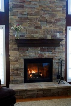 Stone Fireplace Decor stone and brick fireplace. this would look awesome in the corner