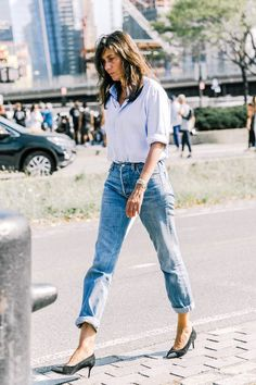 French style muse (and Editor-in-Chief of Vogue Paris) Emmanuelle Alt is the epitome of effortless-cool in a classic blue button-down shirt, cuffed boyfriend-style jeans and suede cap-toe pumps. Keep your accessories, hair, and beauty simple to keep in line with the look.
