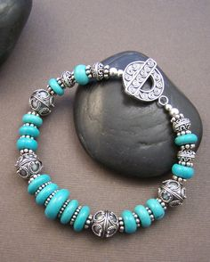 Stunning genuine turquoise discs are strung with ornate Bali sterling silver beads to create this one of a kind bracelet. If you love turquoise