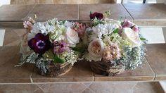 Rustic elegant centerpiece of white hydrangea, white O'Hara garden roses, apricot stock, dusty miller, baby's breath, daisies, and alstromeria by Eden's Echo