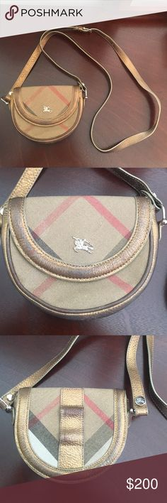 100% AUTHENTIC Burberry Crossbody Burberry cross body satchel. Worn multiple times. The gold is rubbing off on some places, however the bag still looks beautiful. Comes with a long strap. Very simple and cute. Perfect for daytime and night! Burberry Bags Mini Bags