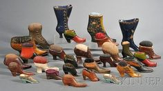 Collection of Twenty-eight Shoe-form Pincushions, late 19th - early 20th century.