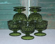 Set of six green Indiana Glass footed sherbet glasses. Pattern is called Whitehall.  Dimensions: 3.25 tall, 3 5/8 across  If youd like to view my