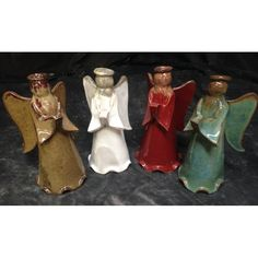 Angels by Fingerprint Pottery - Based in Pontotoc, MS, Fingerprint Pottery was established in 2005. Their pieces use all elements of design with a strong emphasis on texture. Using fingerprints as a primary means of texture, our potters and artists handcraft each piece using stoneware clay bodies and high fire glazes. Fingerprint Pottery is co-owned and operated by Terry Owens and Jim Hough. Visit or call Babcock Gifts in Memphis, TN for additional pieces by Fingerprint Pottery.
