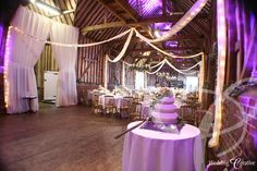 I like the lighted swags from the ceilings. Diy Wedding, Wedding Venues, Dream Wedding, Barn Weddings, Wedding Reception, Uplighting Wedding, Wedding Decorations, Table Decorations, Centerpieces
