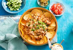 Crunchy nachos piled high and topped with barbecue chicken and tons of cheese. Delicious!