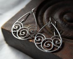 Hey, I found this really awesome Etsy listing at https://www.etsy.com/listing/191896834/swirl-earrings-in-stainless-steel-silver