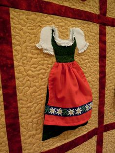 Dirndl Dress Shop by Daniele Tanner   this three dimensional wall hanging features 16 traditional German and Austrian folk dresses.