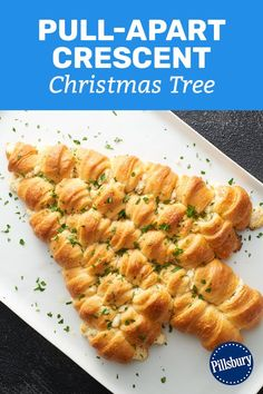 It's official: this is the appetizer we're bringing to every party this holiday season. This cheese-stuffed tree is trimmed with melted butter and fresh parsley for a pull-apart centerpiece that will disappear before the party even starts. Christmas Bread, Christmas Eve, Christmas Foods, Christmas Party Food, Christmas Brunch, Christmas Cooking, Christmas Desserts, Holiday Bread, Christmas Appetizers