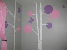 Gray walls with pink and purple accents.  Girls room.