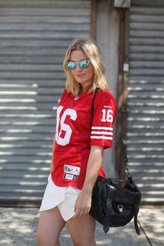 Super Bowl Style - How to Make a Sports Jersey Look Chic - red jersey + white envelope mini skirt and mirrored sunglasses