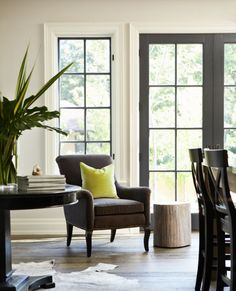 Black french doors and window mullions inside white molding
